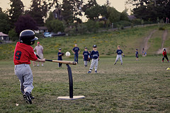 tee ball batting taking a good cut.