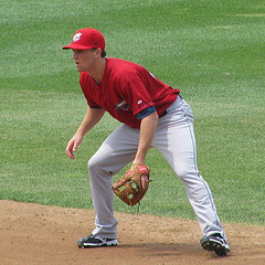 infielder Phelps in ready position for fast catch throwing drills
