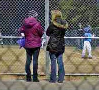 baseball moms enjoying games on cool night