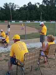 baseball parents intensely following the baseball game