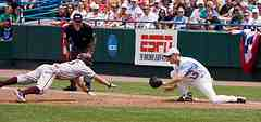 Pick off play runner diving back to first base