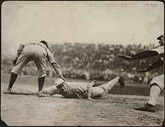 old school runner diving back to first base on pick off throw