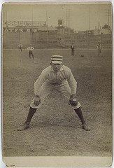 old school baseball infielder and baseball glove