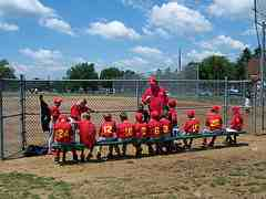 Baseball Players in the dugout ready to play